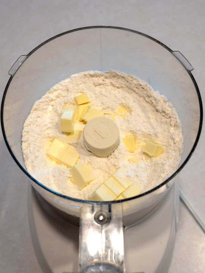 Cut pieces of butter in Food Processor for Southern Flaky Biscuits
