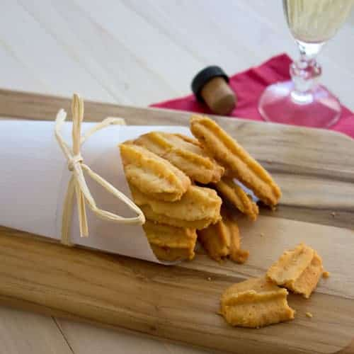 Cheese Straws are a highly addictive southern classic. Crispy and buttery, Southern Cheese Straws are amazing when paired with a dry sherry, or just by themselves.  It's impossible to eat just one!