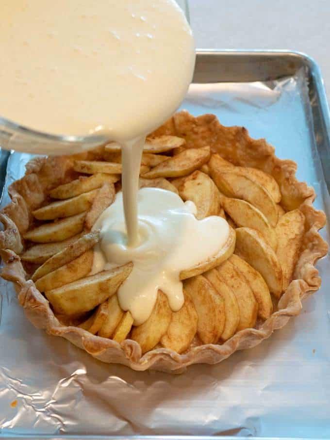 Adding Custard to Baked Apples for Tarte Normande aux Pommes