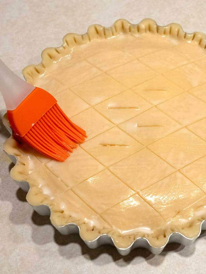 Brushing Top Crust with Milk for the Cheese and Onion Pie