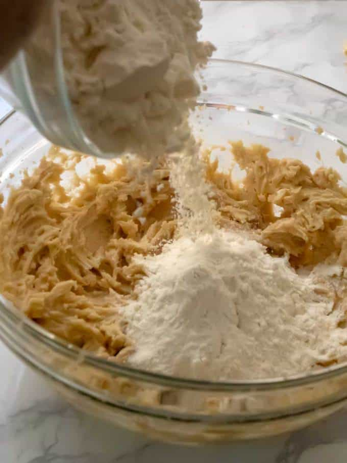 Adding Flour to Chocolate Chip Oatmeal Cookie Dough