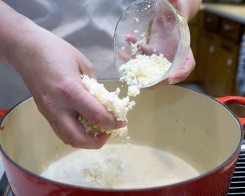 Adding Mozzerella to pan