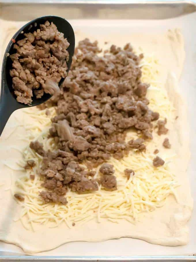 Adding Sausage to bread dough and cheese for Sausage Bread
