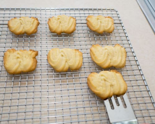 Transferring Viennese Sablés to cooling rack