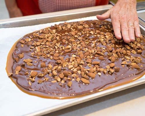 Pressing almonds into chocolate