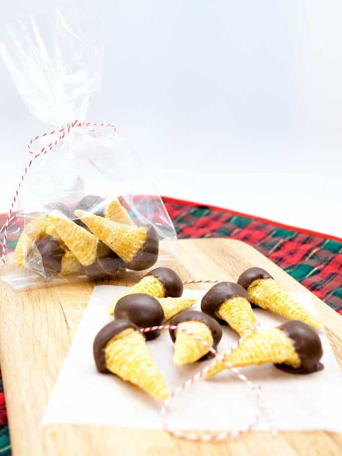 Chocolate-Dipped Peanut Butter Bugles: Delight your family and friends with these sweet, salty, and crunchy holiday treats.
