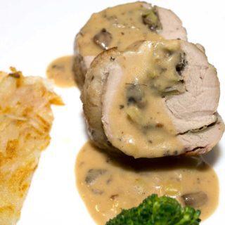 Mushroom Stuffed Pork Tenderloin with Madeira Cream Sauce