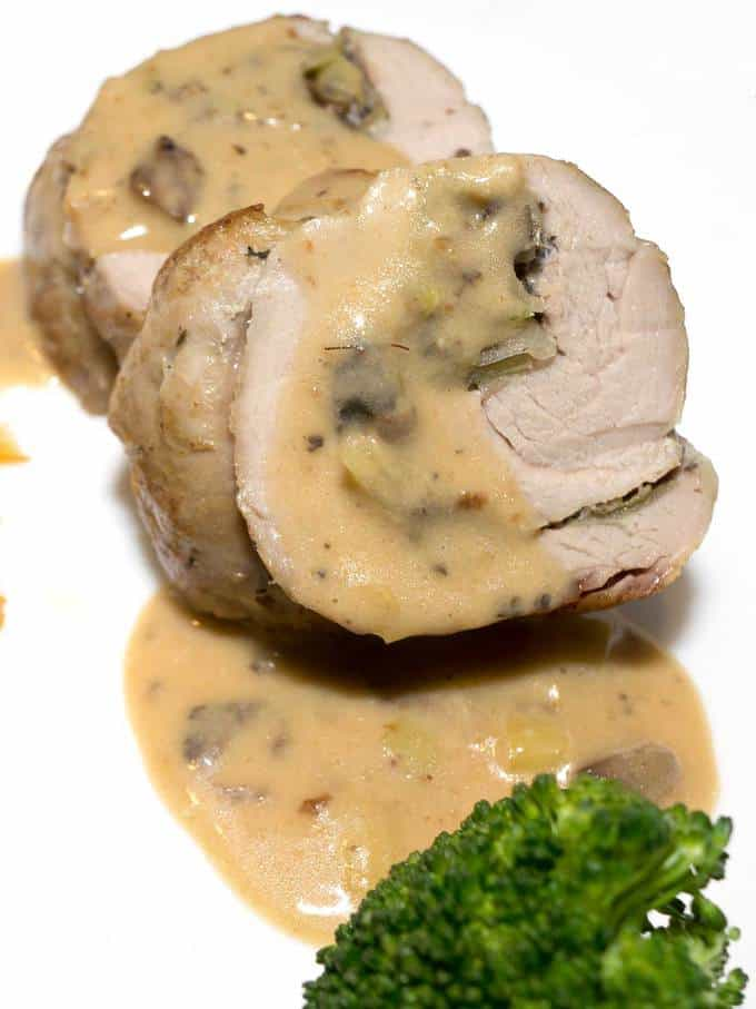 Mushroom Stuffed Pork Tenderloin with Madeira Cream Sauce