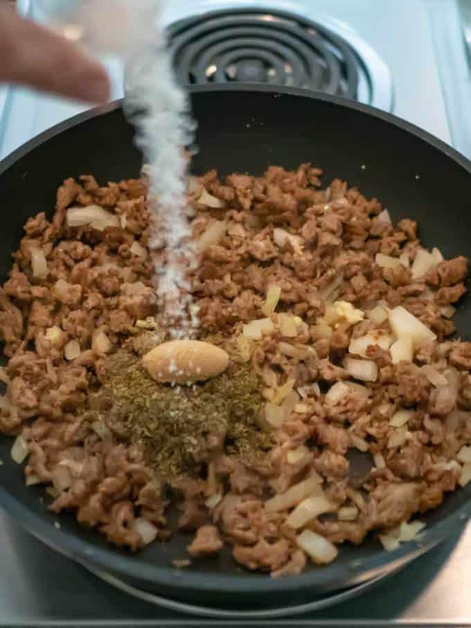 Adding salt to sausage mixture for Bolognese Sauce