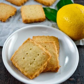 "Lemon Sablés, with their characteristic ""sandy"" texture, are buttery rich with a delicate hint of lemon from lemon zest."