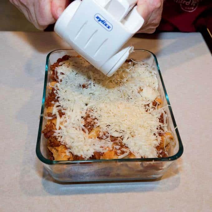 Adding Parmesan cheese