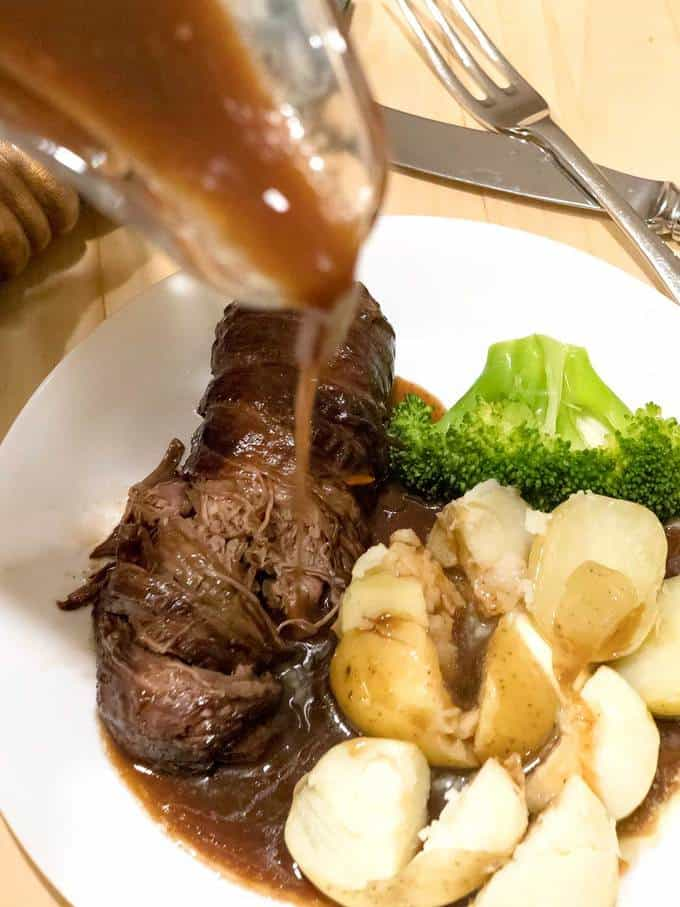 Beef wrapped around a savory stuffing, and cooked in a brown sauce.