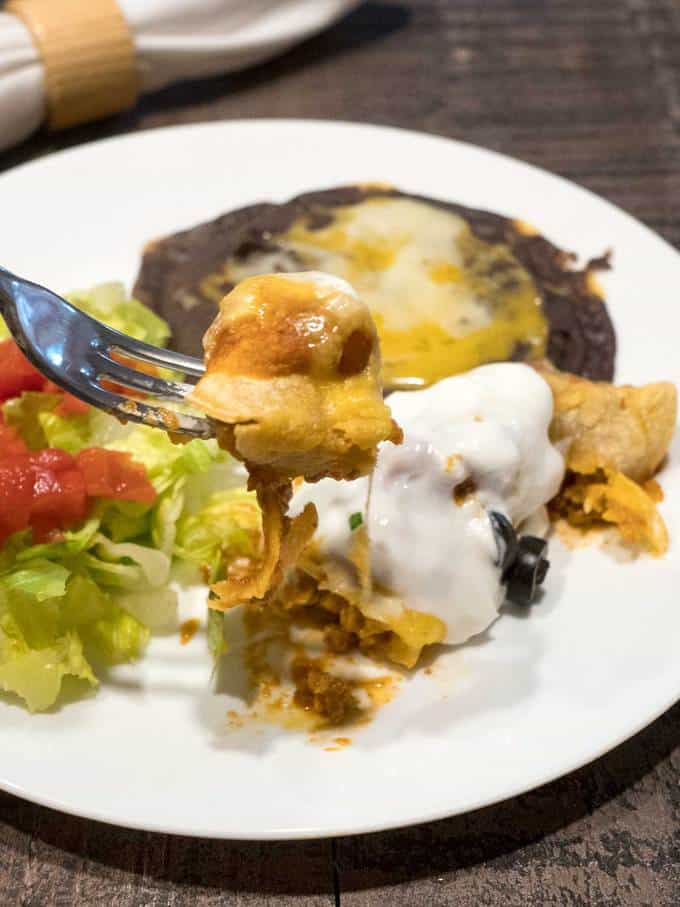 Enchiladas with smashed black beans and salad