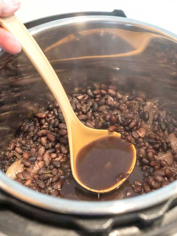 Removing excess liquid from black beans