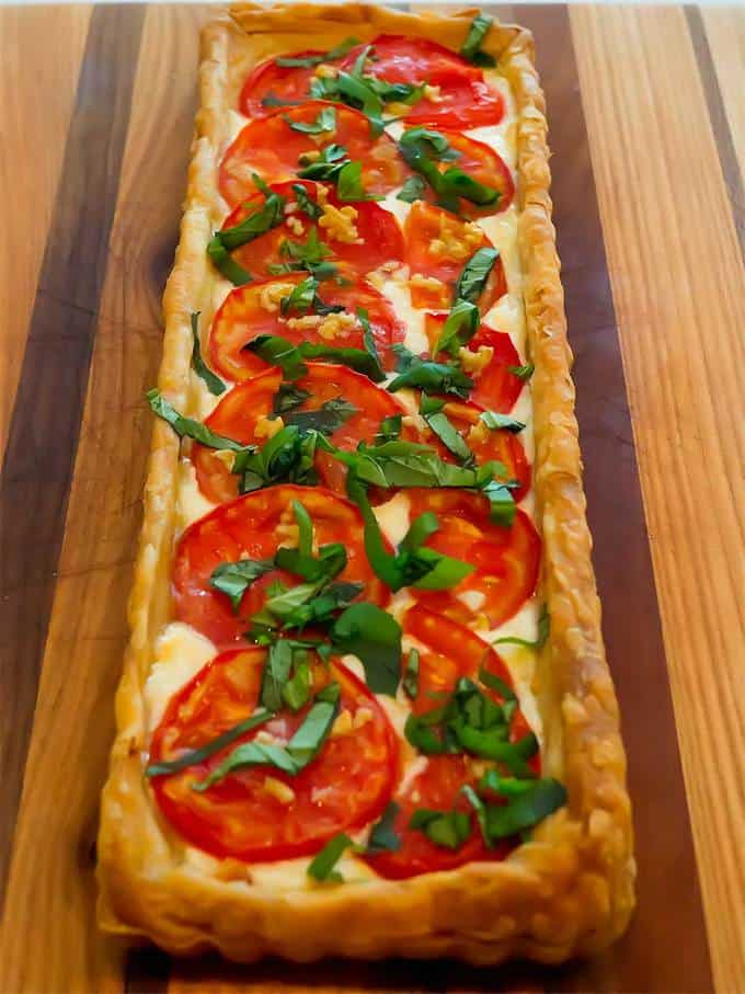 Fresh tomatoes in a creamy base with puff pastry crust