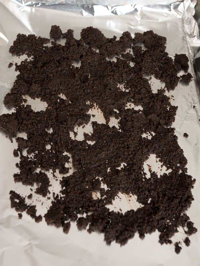 Wet coffee grounds on baking sheet