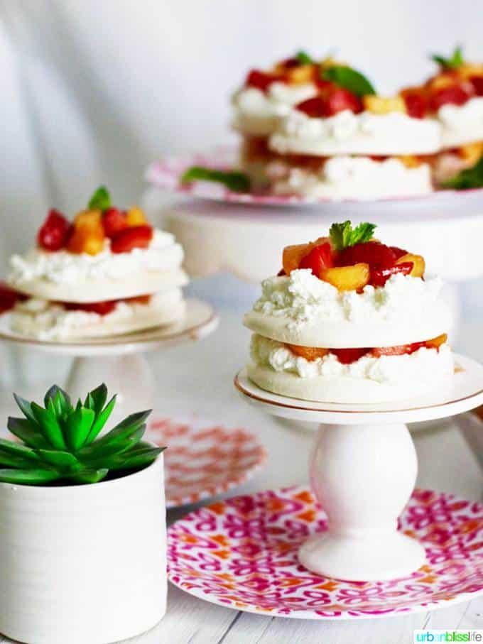 Mini Pavlova Cakes with Strawberries, Peaches, and Cream