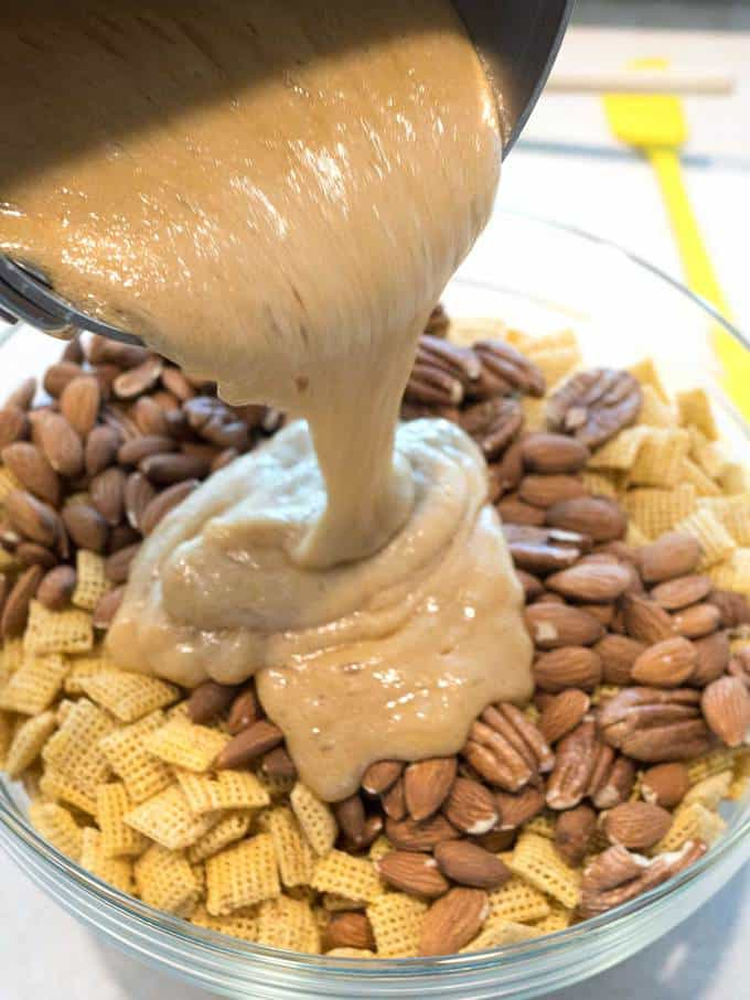 Pouring Caramel Over Chex and Nuts