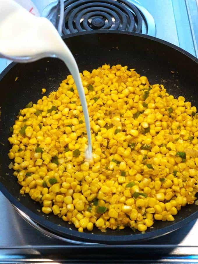 Adding Cream to Cajun Corn Maque Choux