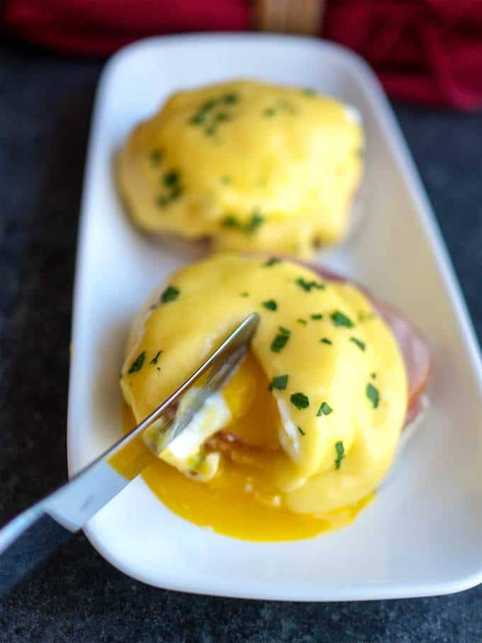 Cutting into Classic Eggs Benedict