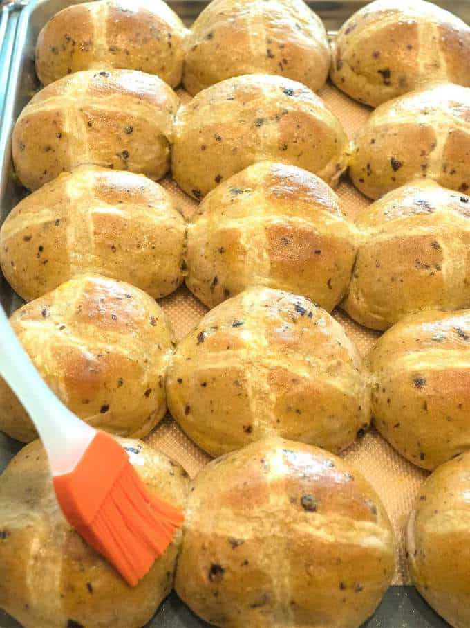 Brushing Hot Cross Buns with Egg Wash