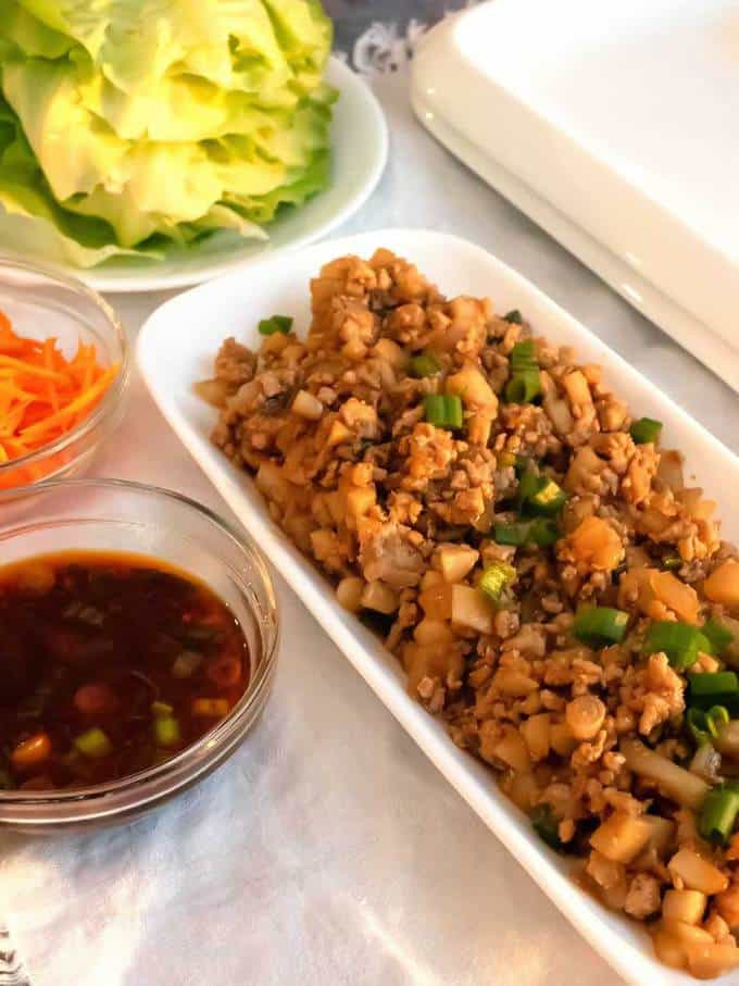 Preparing to Serve the Easy Asian Lettuce Wraps with Spicy Dipping Sauce