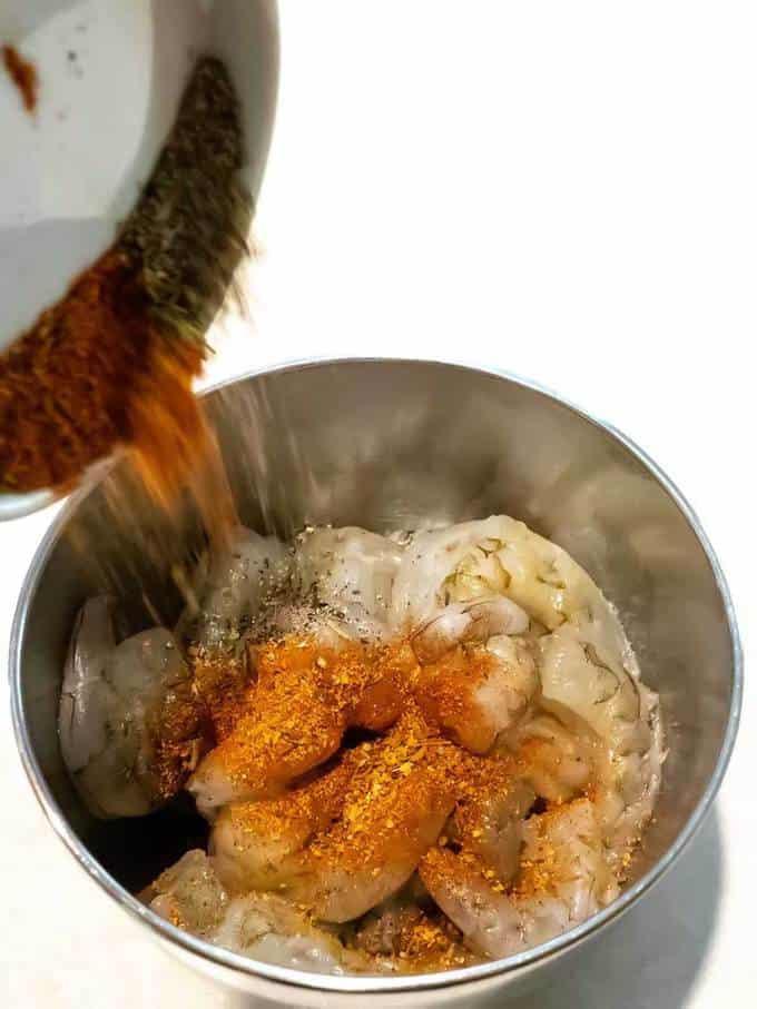 Adding Spices to Shrimp for Easy Shrimp Scampi