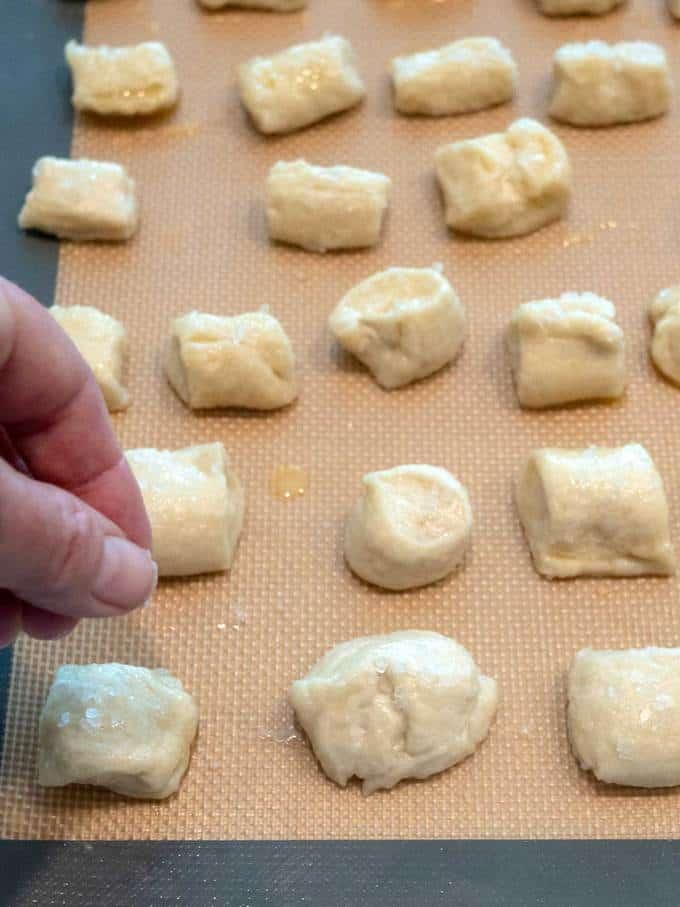 Sprinkling Salt on Pretzel Bites Before Baking