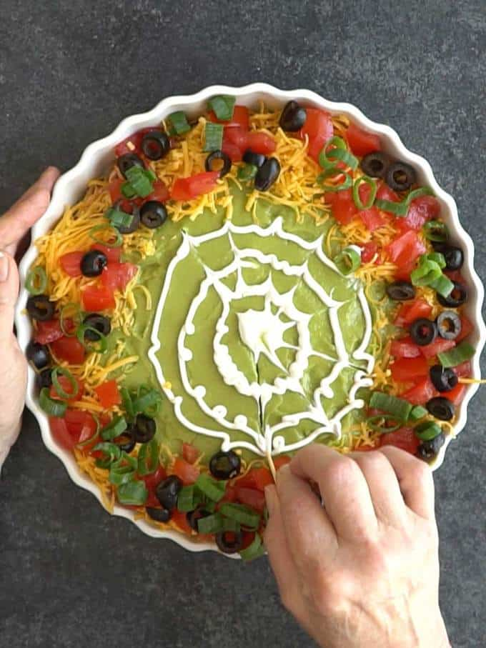 Making the Spider Web for the Spooky 8-Layer Taco Dip