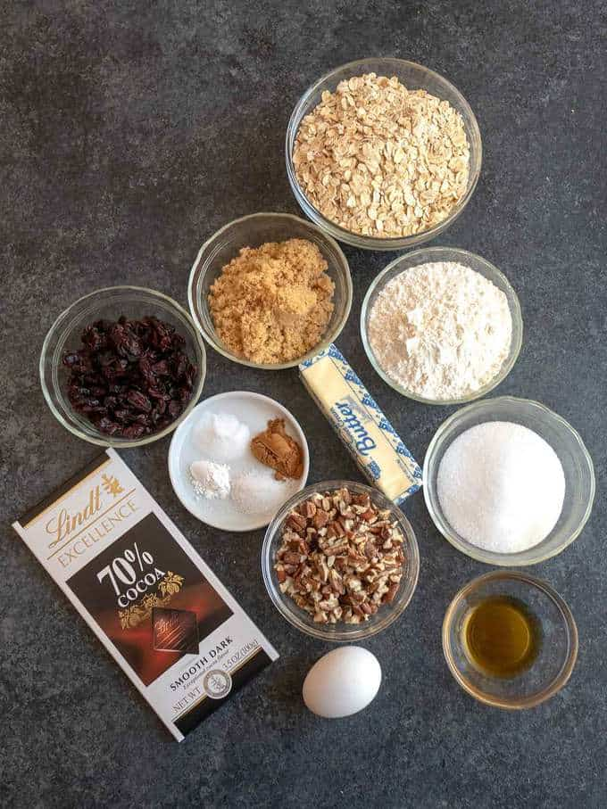 Ingredients for Chocolate Chunk Oatmeal cookies with dried cranberries and toasted pecans