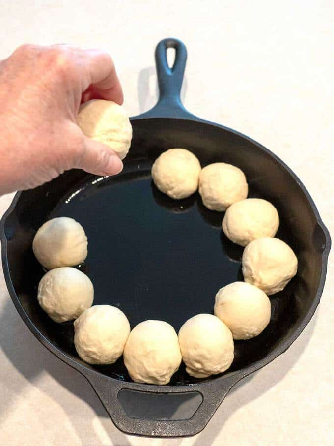 Placing Dough in Cast Iron Pan for Spinach Artichoke Bread Ring Dip