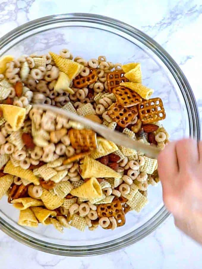 Mixing Ingredients for Mardi Gras Snack Mix