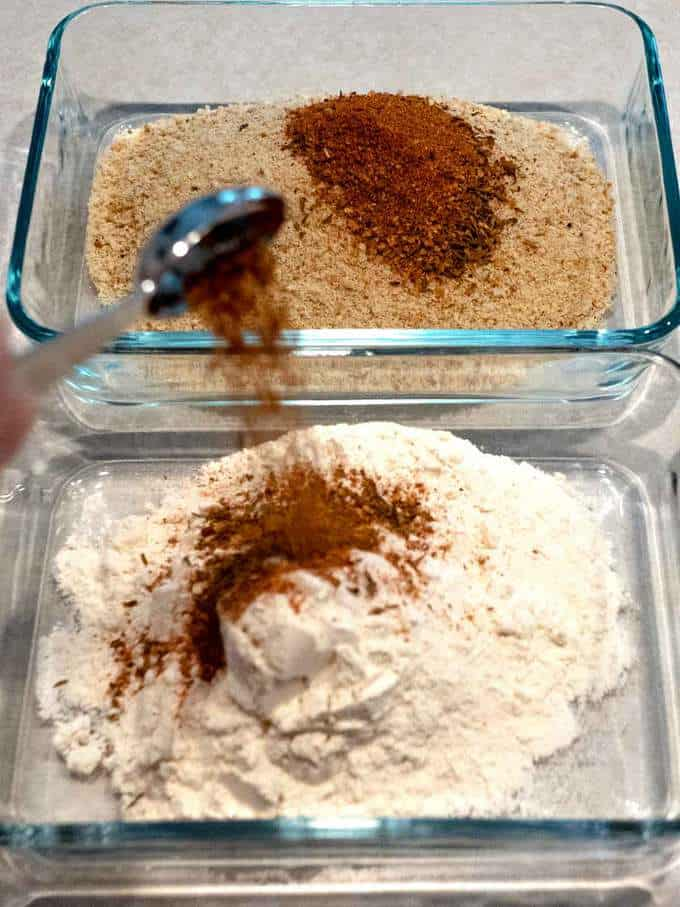 Seasoning the flour for the breading of the Cajun Pork Boulettes