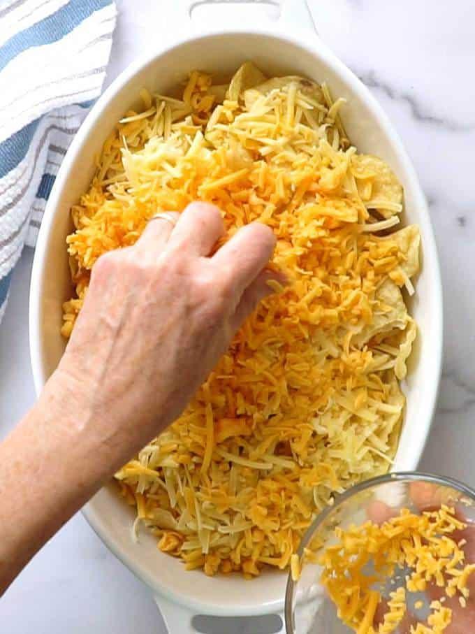 Adding Cheddar Cheese for Irish Nachos