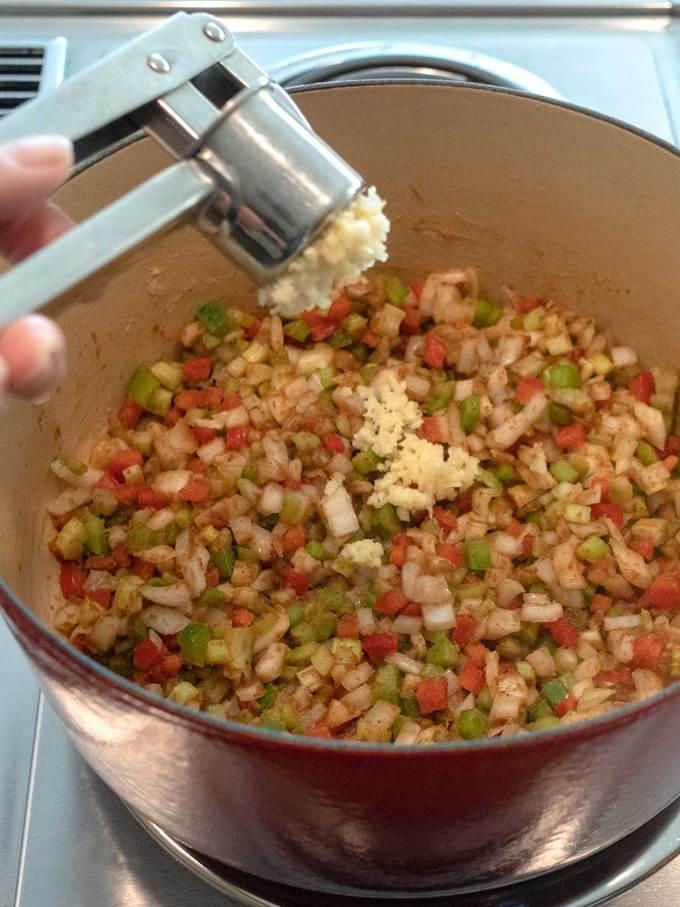 Adding Garlic for Chicken Étouffée
