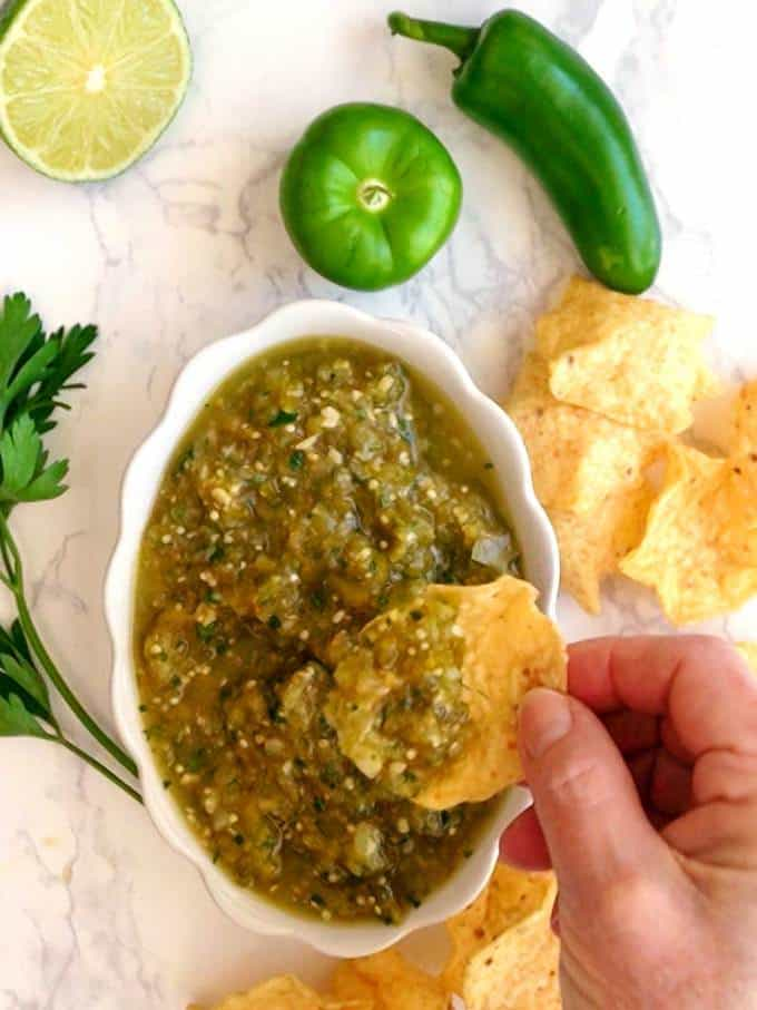Dipping into Salsa Verde with Tortilla chip