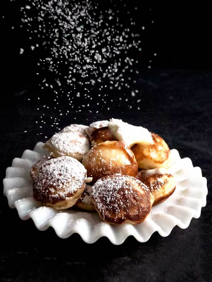 Poffertjes with sprinkling of confectioners' sugar