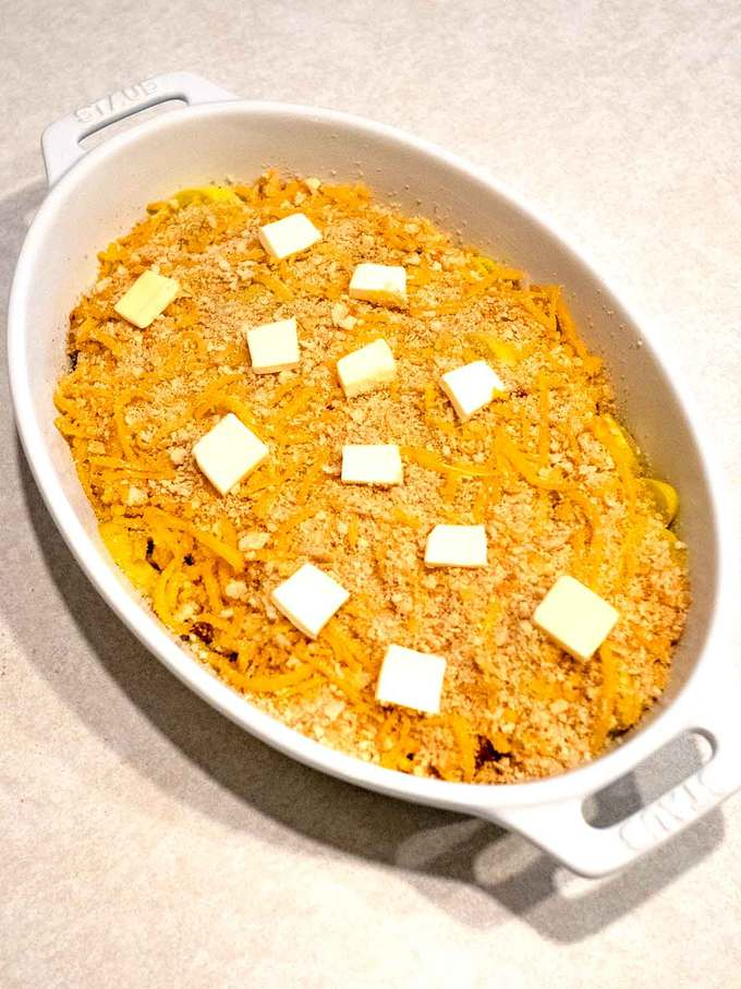 Squash Casserole with Ritz/Cheese topping dotted with butter