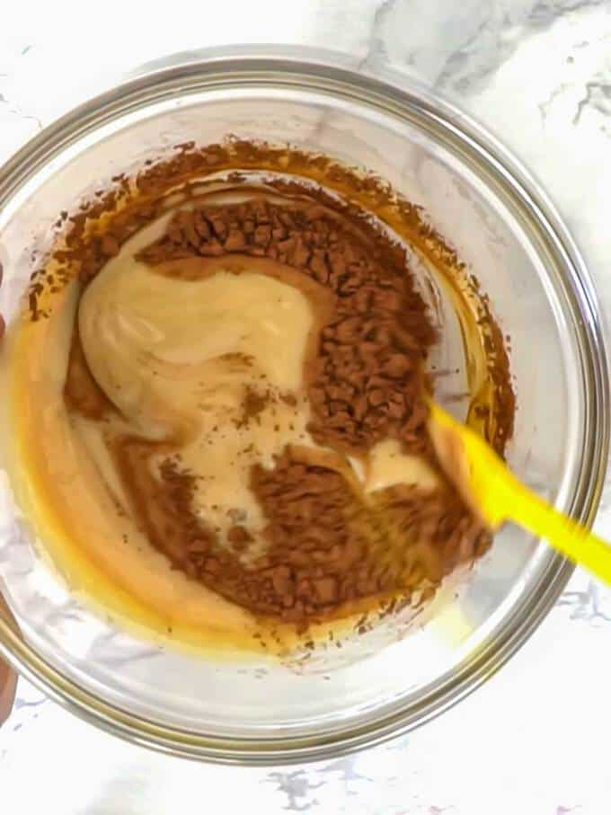Stirring Cocoa and Sweetened Condensed Milk Together