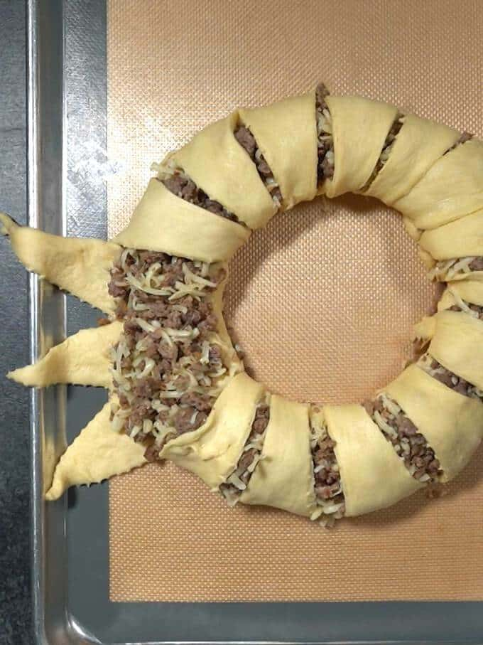 Enclosing Sausage Mixture with Crescent Dough