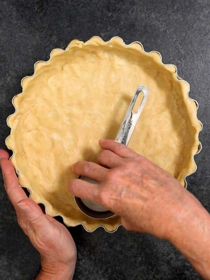 Smoothing the Quiche Dough with Straight Sided Measuring Cup