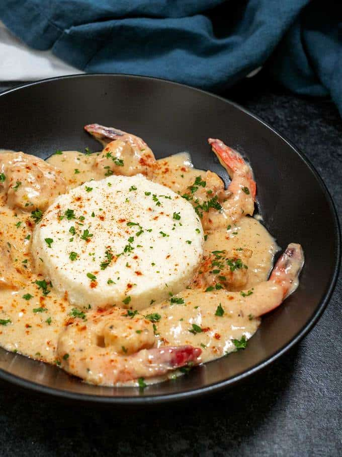 Fresh Shrimp cooked in a creamy garlic snd parmesan sauce and served over Boursin grits