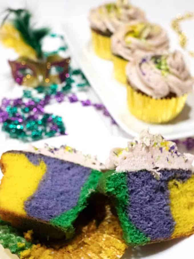 Cut cupcake showing the colorful interior