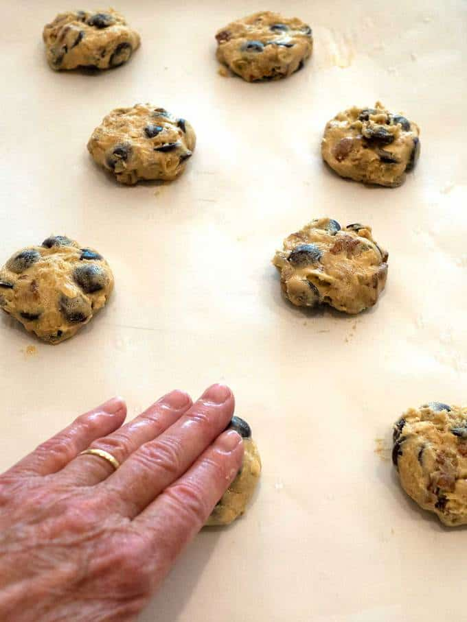 Flattening Dough with damp fingers