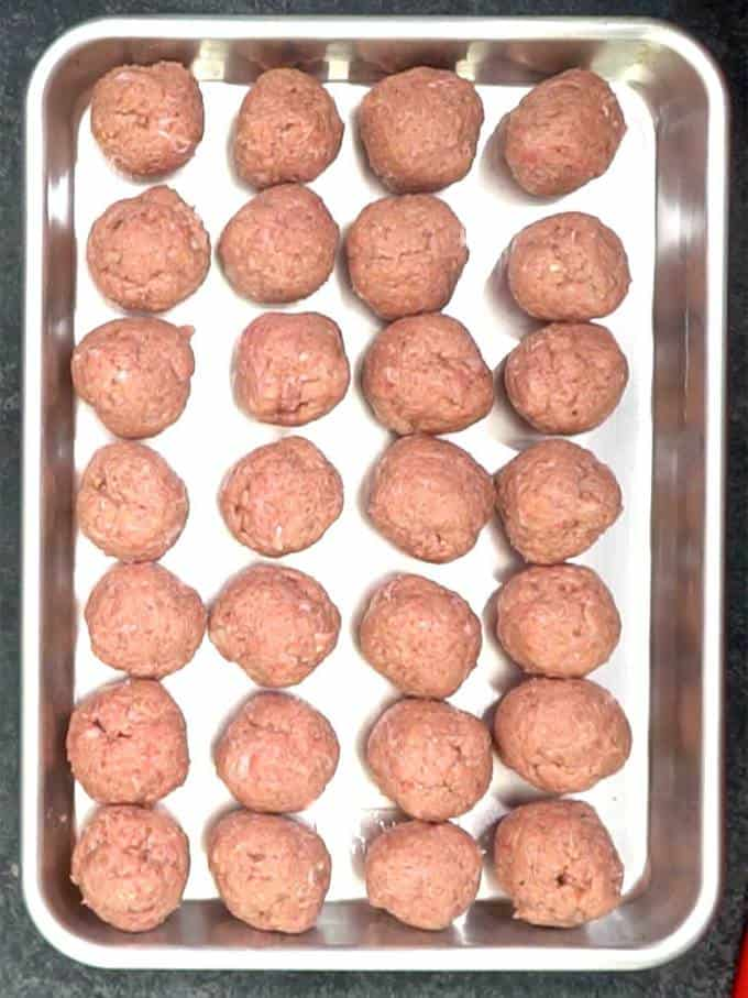 Rolled meatballs ready to cook
