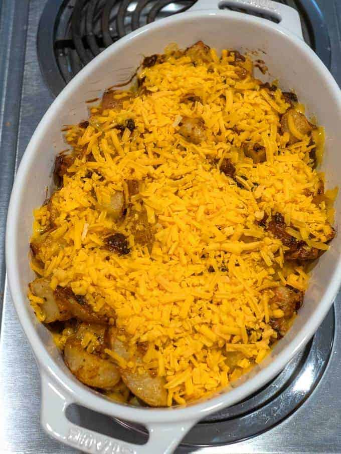 Adding additional cheese to the potatoes
