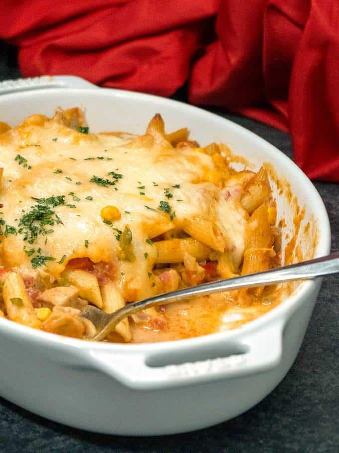 Southwestern Chicken Pasta in casserole dish with spoon