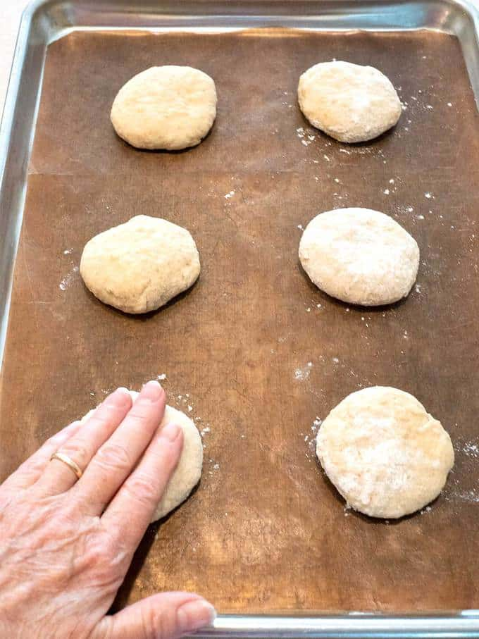 Flattening Dough with floured hands