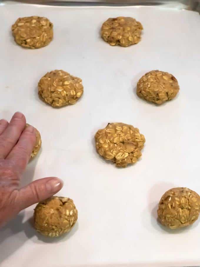 Flattening Cookies with damp hand