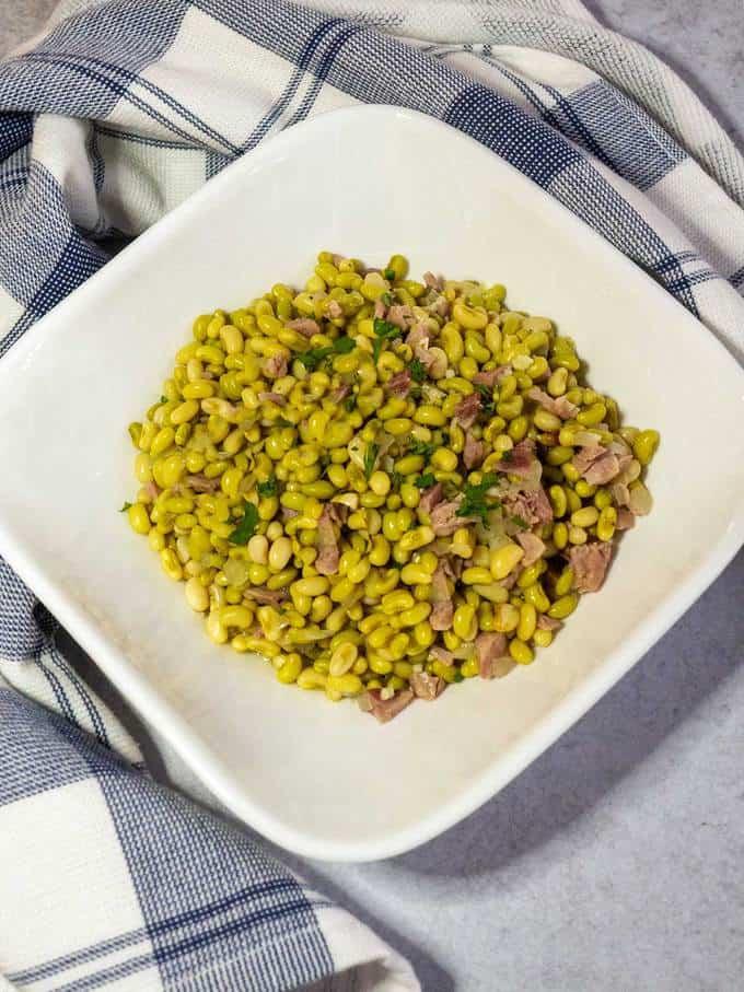 White acre peas in white bowl